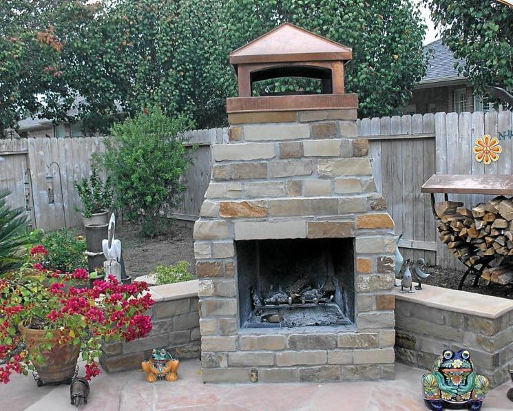 Oklahoma Chop Rock Outdoor Fireplace With Sitting Benches.